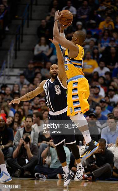Denver Nuggets shooting guard Randy Foye takes a shot over Oklahoma City Thunder point guard Derek Fisher during the fourth quarter January 9 2014 at...