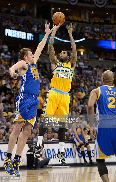 Denver Nuggets shooting guard Wilson Chandler shoots over Golden State Warriors power forward David Lee in the first quarter The Denver Nuggets took...