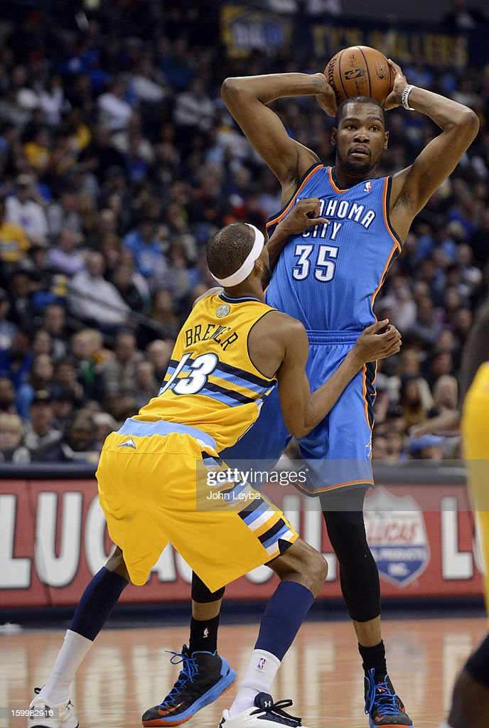 Denver Nuggets small forward Corey Brewer (13) closely guards Oklahoma City Thunder small forward Kevin Durant (35) as he looks to make a pass during the third quarter January 20, 2013 at Pepsi Center. The Denver Nuggets defeated the Oklahoma City Thunder 121-118.