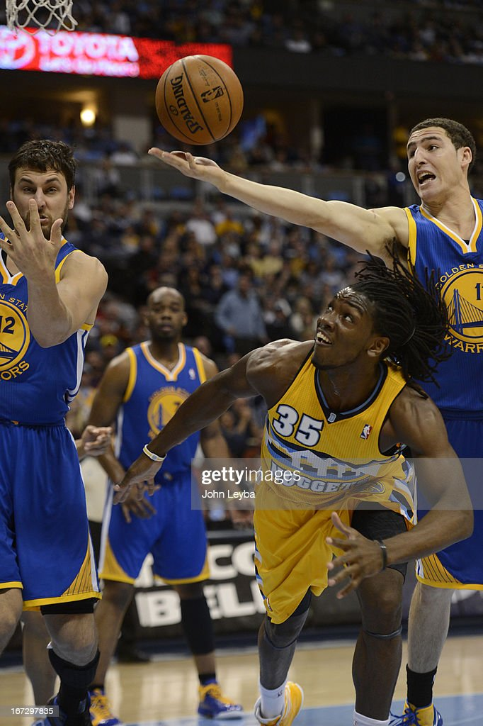 Denver Nuggets small forward Kenneth Faried (35) battles with Golden State Warriors center Andrew Bogut (12) and Golden State Warriors shooting guard Klay Thompson (11) for a loose ball in the second quarter. The Denver Nuggets took on the Golden State Warriors in Game 2 of the Western Conference First Round Series at the Pepsi Center in Denver, Colo. on April 23, 2013.