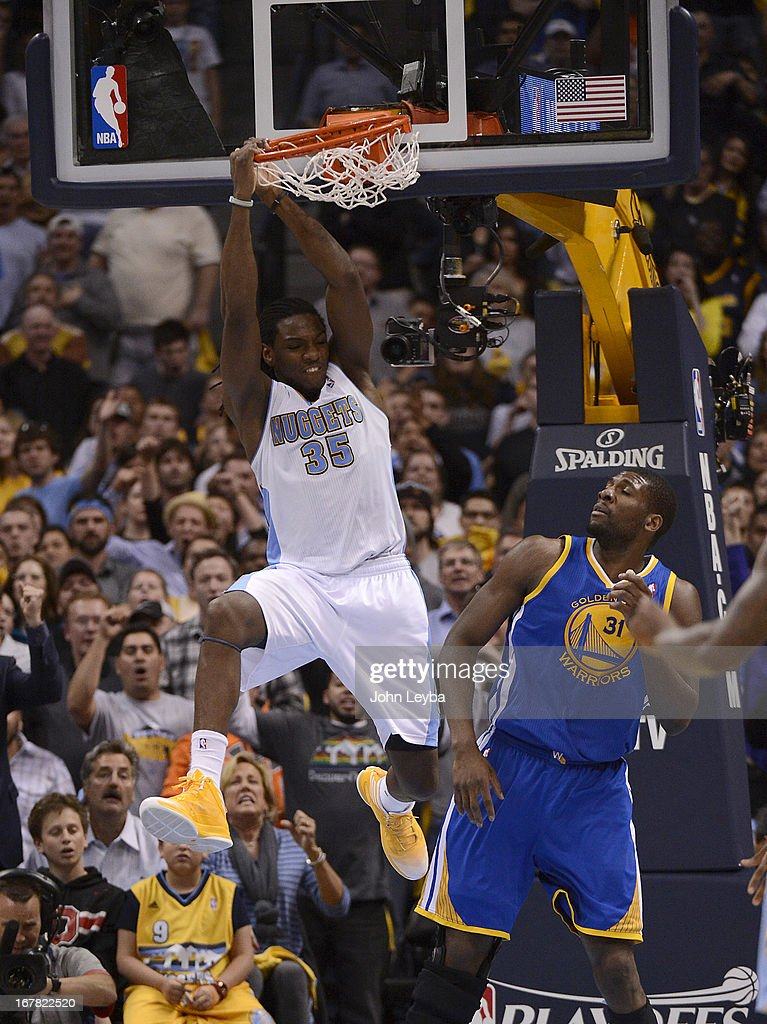 Denver Nuggets small forward Kenneth Faried (35) dunks the ball over Golden State Warriors center Festus Ezeli (31) in the fourth quarter. The Denver Nuggets took on the Golden State Warriors in Game 5 of the Western Conference First Round Series at the Pepsi Center in Denver, Colo. on April 30, 2013.