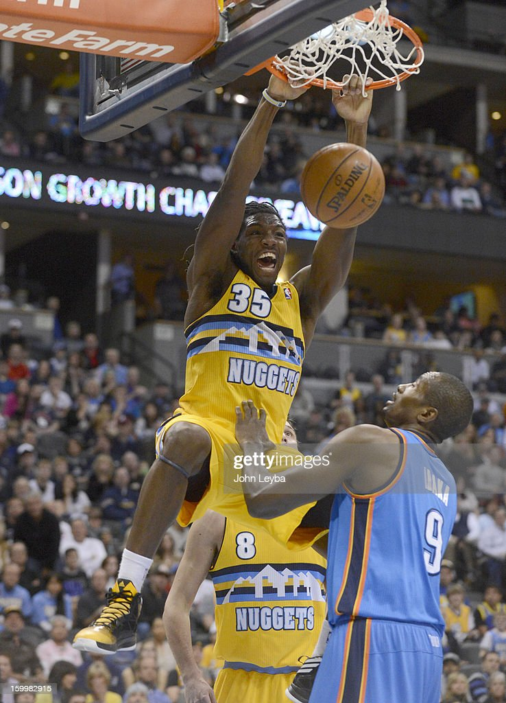 Denver Nuggets small forward Kenneth Faried (35) screams out after slamming down a dunk on Oklahoma City Thunder power forward Serge Ibaka (9) during the first quarter January 20, 2013 at Pepsi Center. The Denver Nuggets defeated the Oklahoma City Thunder 121-118.