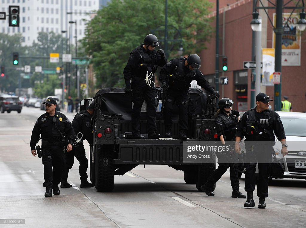 Denver Officers in tactical gear unload along 14th Ave near California during a anti-Trump protest across the street from the Colorado Convention Center where Mr. Trump was speaking July 01, 2016.