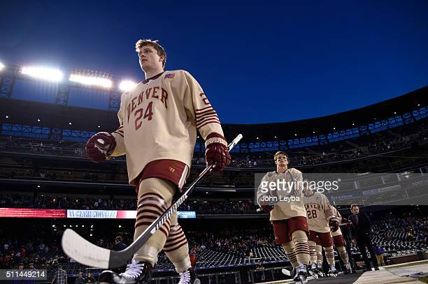 Denver Pioneers forward Colin Staub heads to the ice to take on Colorado College during the Battle On Blake February 20 2016 at Coors Field
