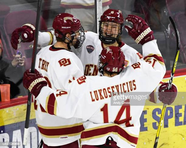 Denver Pioneers forward Henrik Borgström second from left and forward Jarid Lukosevicius celebrate Denver Pioneers forward Troy Terry's goal against...