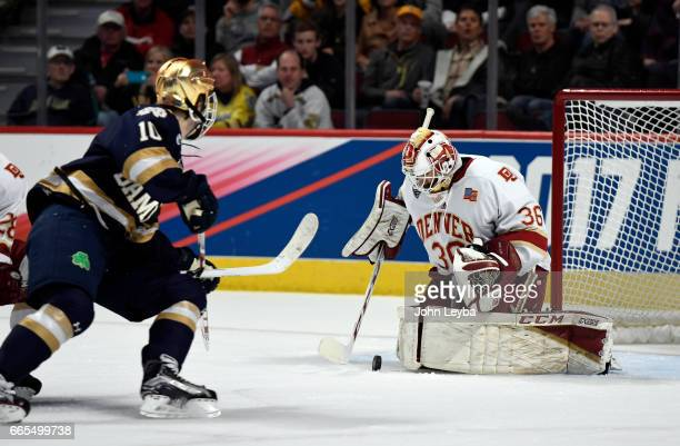 Denver Pioneers goalie Tanner Jaillet makes a save on a shot by Notre Dame Fighting Irish forward Anders Bjork during the second period on April 6...