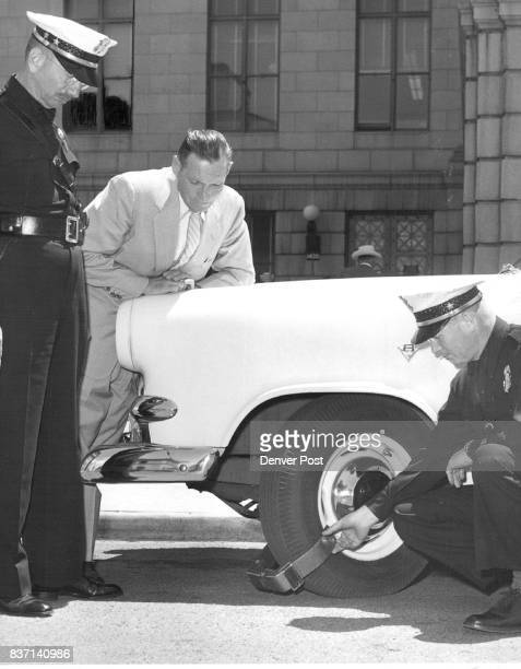 Denver Police Chief Walter Johnson Dan Stills and Robert Newbury study a carhobbling device dubbed the 'Denver boot' which the police department may...