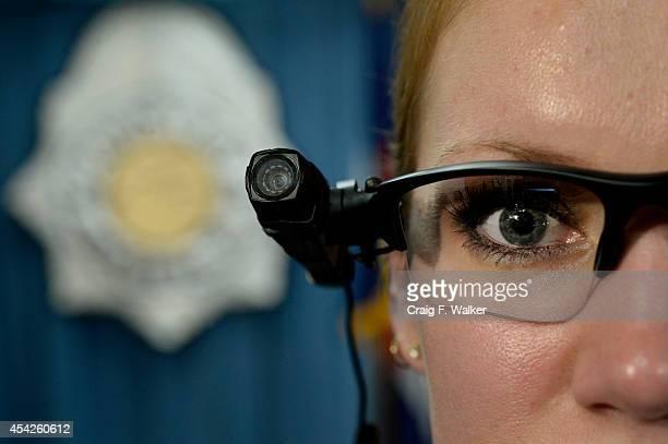 Denver police commander Magen Dodge displays a body cameras following a press conference at the Denver Police Department in Denver CO August 27 2014...