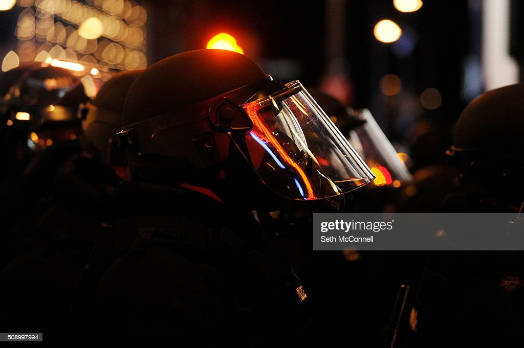 Denver Police keep an eye on fans at they celebrate after the Denver Broncos win in Super Bowl 50 in Denver, Colorado on February 7, 2016. Broncos fans gathered around Denver to cheer on the team as they took on the Carolina Panthers in Super Bowl 50.