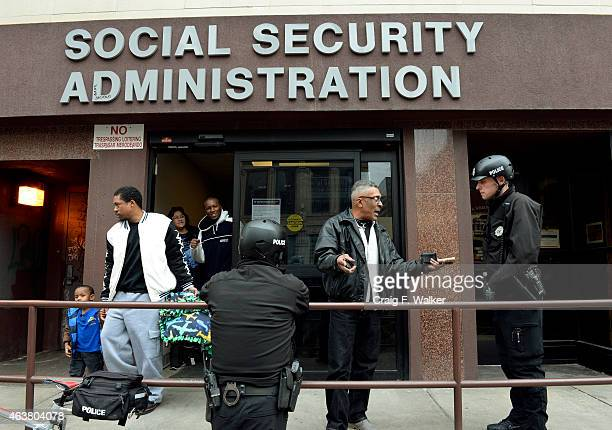Denver Police Officer Robert Southern right and his partner Officer Darren Ulrich talk with Virgil McFarland outside the Social Security...