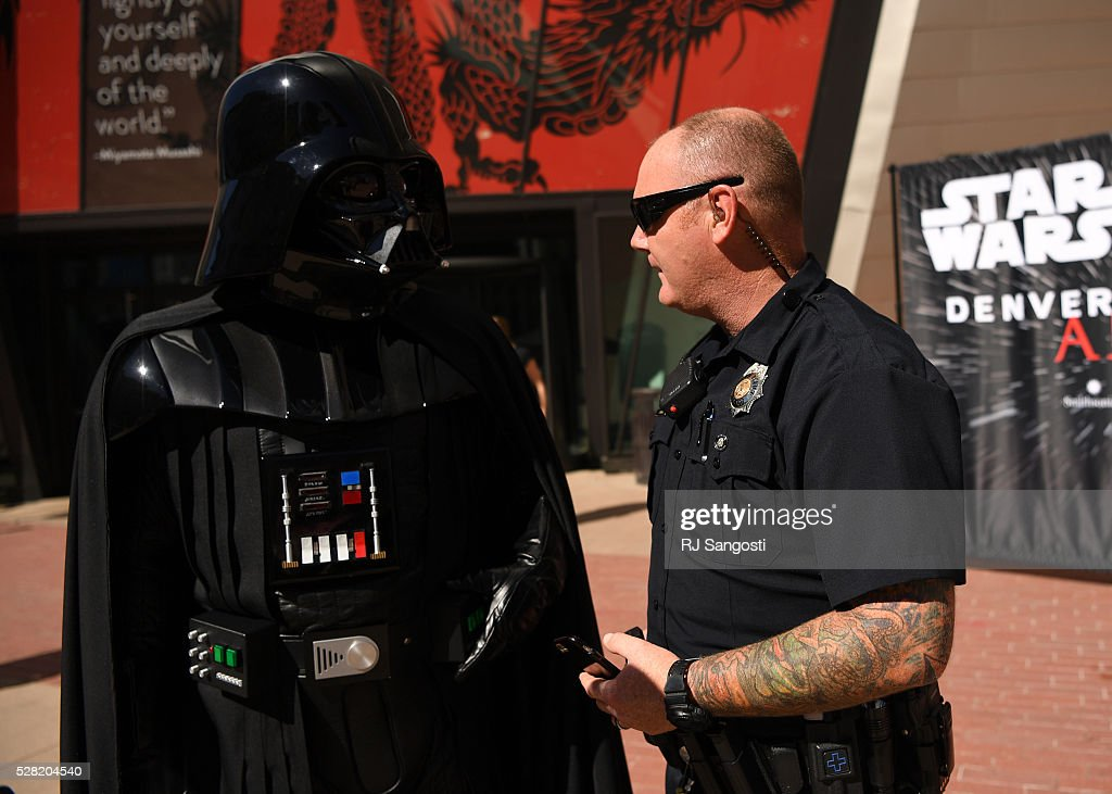 Denver Police Officer Steve Hammack talks with Darth Vader outside the Denver Art Museum, May 04, 2016. The museum held a May the 4th Be With You event to kick off ticket sales for the upcoming exhibition, Star Wars and the Power of Costume, opening at the DAM in November.