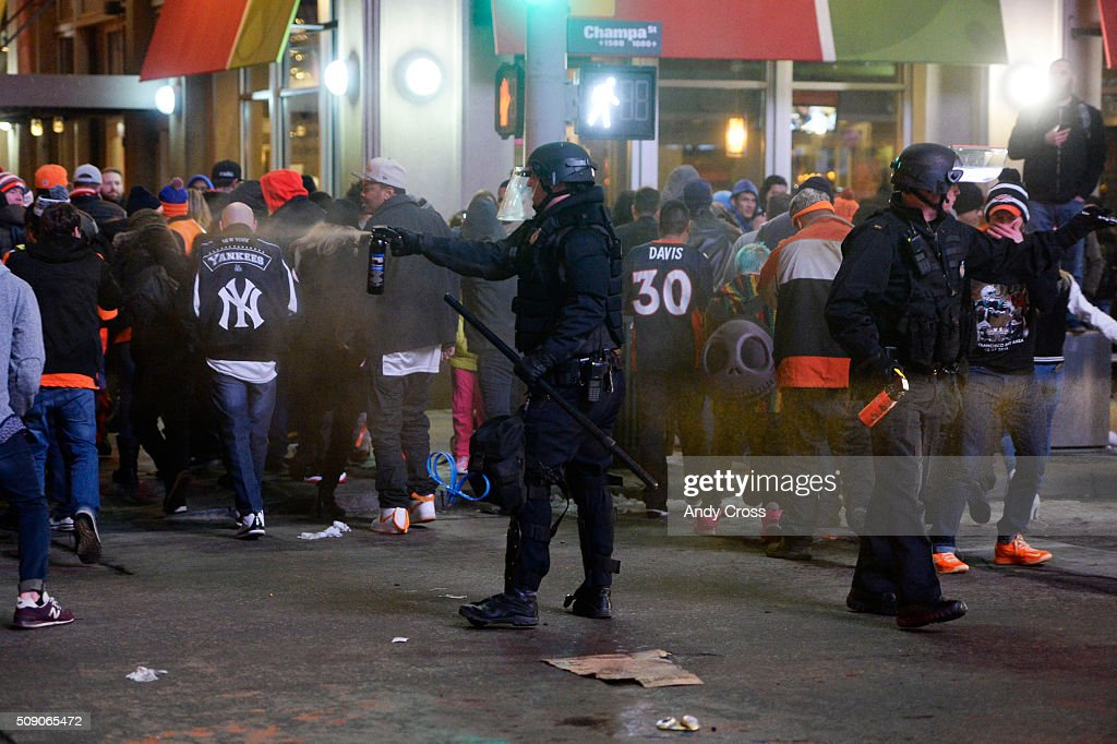 Denver Police spray pepper spray to suppress rowdy crowds on the 16th St Mall during a Denver Broncos Super Bowl celebration February 07 2016