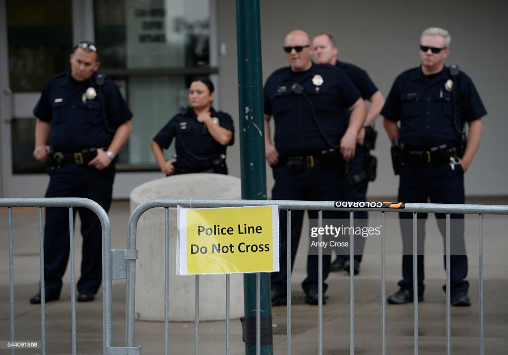 Denver Police stand by in front of the Colorado Convention Center during a anti-Donald Trump protest at 14th and California.