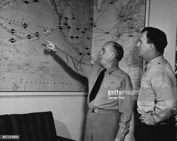 Denver Post Staff Writer George McWilliams listens as Rear Adm John M Hoskins explains the military air transport service operation at Hickam air...