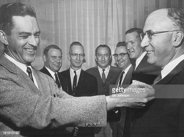 DEC 18 1961 DEC 21 1961 Denver Press Club Honors Judge Bob Collins left president of the Denver Press Club attaches pin to the lapel of County Judge...