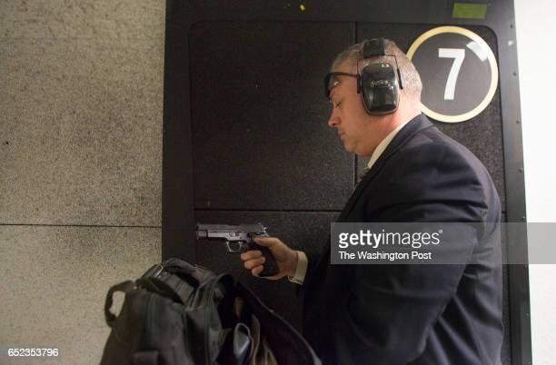 Denver Riggleman a Republican candidate for Virginia governor prepares to shoot his 45caliber pistol during a 'shoot and greet' Saturday March 4 2017...