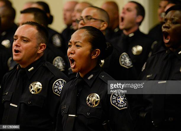 Denver Sheriff's recruit Victoria FerminWeinreb along with the rest of the recruits shouts out after being recognized as graduates of the 2016 Denver...
