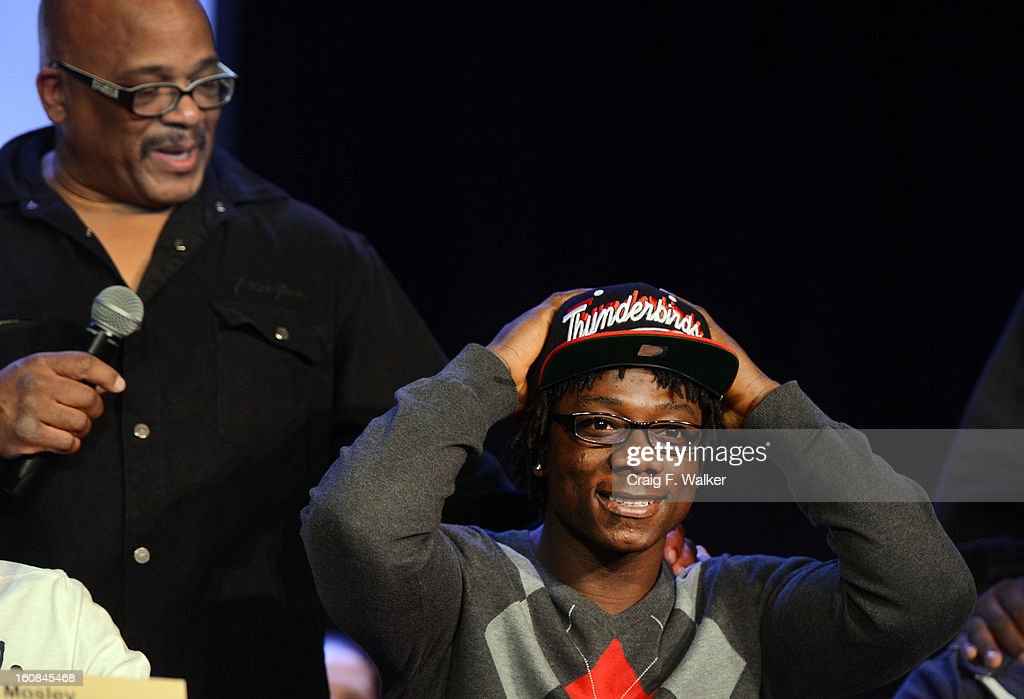 Denver South High School football coach Tony Lindsay Sr. introduces player Pete Williams during a signing day ceremony at the school in Denver, CO February 06, 2013. Williams signed with Southern Utah University.