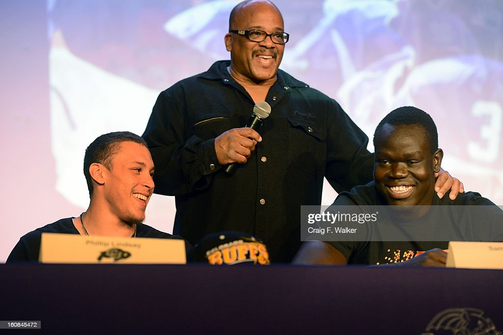 Denver South High School football coach <a gi-track='captionPersonalityLinkClicked' href=/galleries/search?phrase=Tony+Lindsay&family=editorial&specificpeople=3435613 ng-click='$event.stopPropagation()'>Tony Lindsay</a> Sr. introduces players Phillip Lindsay, left, and Samuel Mabany during a signing day ceremony at the school in Denver, CO February 06, 2013. Phillip Lindsay signed with the University of Colorado and Mabany signed with the University of New Mexico.