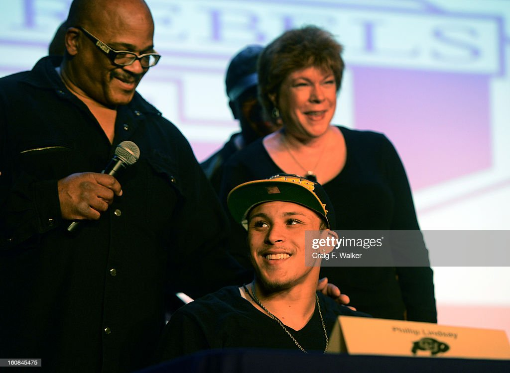 Denver South High School football coach Tony Lindsay Sr. introduces player Phillip Lindsay and his parents, Diane and Troy, during a signing day ceremony at the school in Denver, CO February 06, 2013. Phillip Lindsay signed with the University of Colorado.