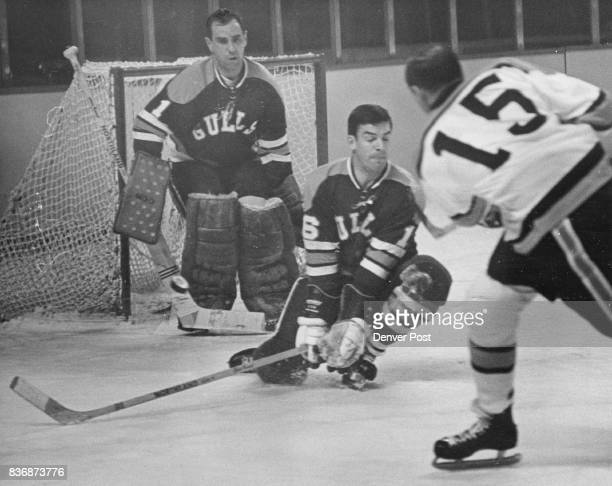 Denver Spurs 5p 1st Period Save LowFlying Gull Deflects Puck San Diego defenseman Jim Cardiff bats away a shot by Denver's Billy Carter as Gull...