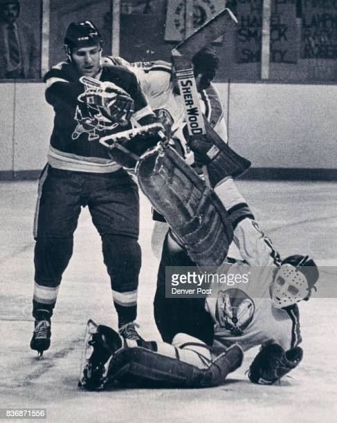 Denver Spurs 'Here Here fellow Icing the Goalie is a No No' Bob Johnson Denver Spurs goalie holds onto the puck on this save despite efforts by...