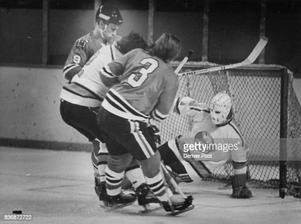 Denver Spurs It's Two Against Two in Front of Spurs Goal Defenseman Bob McCord and goalie Jim Watt of Denver team thwart scoring attempt by Dallas's...