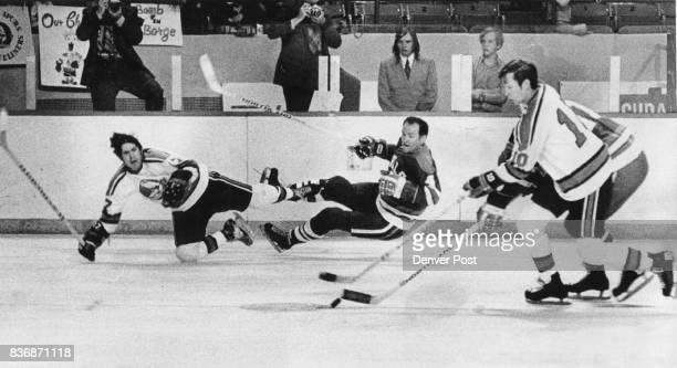 Denver Spurs Tough to Determine Where the Action is Denver's Ron Buchanan and San Diego's Orest Kindrachuk wage battle for control of the puck while...