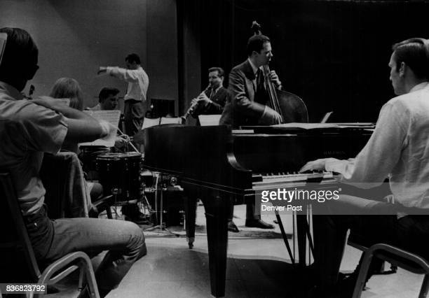 Denver Symphony Orchestra Symphony Rehearses For Jazz Concert The Denver Symphony Orchestra Thursday was rehearsing with the Bill Smith Quartet in...