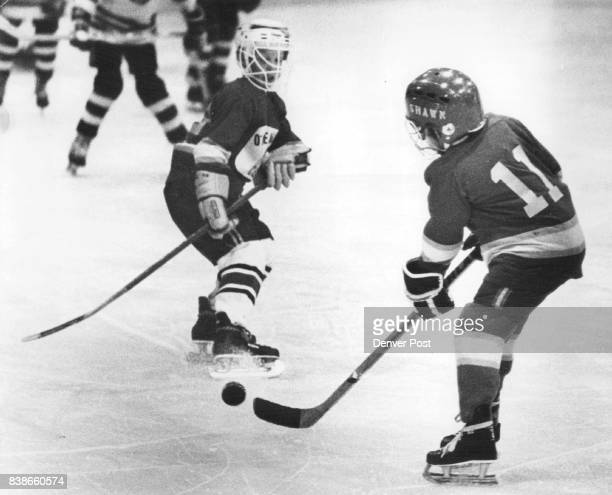 Denver University Athletics Ice Hockey Shawn Gates Fields Puck as Teammate Skids to Halt Gates and University of Denver teammates defeated Hyland...