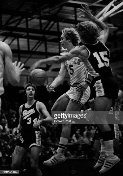 Denver University Basketball Pioneer pass produces points Jim Ranson of Denver Pioneers gets pass to teammate Bob Heaton netting DY a field goal...