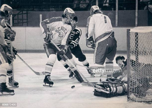 Denver University * Ice Hockey Du Goalie Lays Down on Job for Reason Denver's Ron Grahame has just kicked out shot by CC's Steve Sertich and...