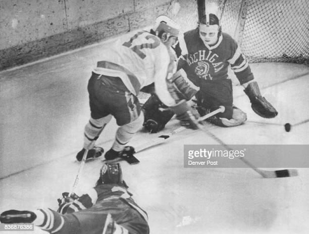 Denver University * Ice Hockey Spartan Netminder Shuts off Pioneer's Goal Bid Michigan State goalie Jim Watt saved on this shot by Bob Krieger while...