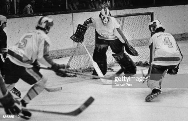 Denver University Ice Hockey Then Gets a Lot of Help in Making Another Stop Pioneers Bruce Affleck and Mike Busniuk assist in clearing puck from in...