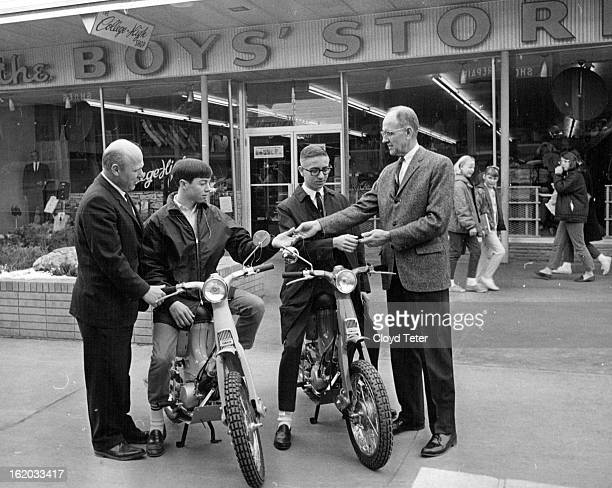 FEB 29 1964 MAR 4 1964 Denver Winner in National Contest Receive Motorcycle Prizes Hob Jones and E R Jensen of the Boys' Store and College High Shop...