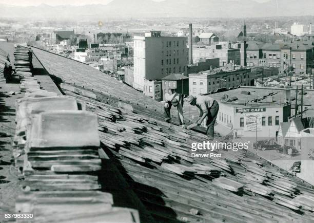 Denver Workmen remove tile roof of the City and County building in preparation for installing of a new $66000 roof on the blocklong building Supply...