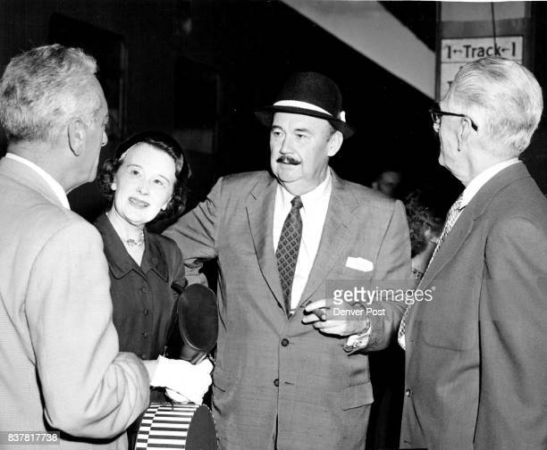 Denver's Paul Whiteman the 'king of jazz' and his wife chat with Saul Caston conductor of the Denver Symphony orchestra and Charley Scheuerman member...