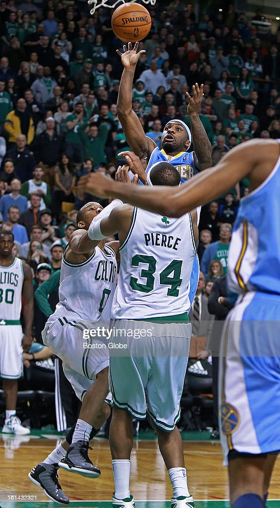 Denver's Ty Lawson hits a shot over the Celtics' Avery Bradley and Paul Pierce at the end of regulation that tied the game at 92-92, and sent the game into the first of three overtime periods. The Boston Celtics hosted the Denver Nuggets in a regular season NBA game at the TD Garden.