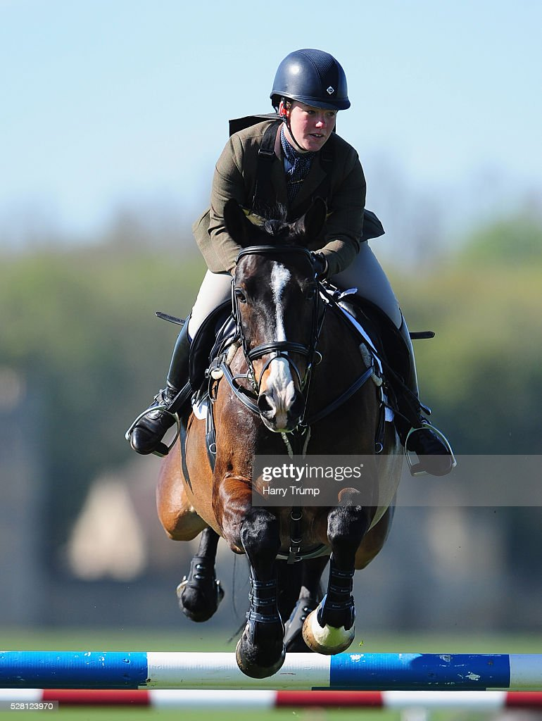 Denys De La Mer ridden by Lola Watt takes a jump during the Mitsubishi Motors Cup Showing Jumping during Day One of the Badminton Horse Trials on May 4, 2016in Badminton, Untied Kindom.