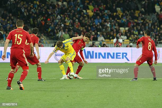 Denys Garmash of Ukraine national team vies with Cesc F��bregas of Spain during the European Qualifiers 2016 match between Ukraine and Spain national...