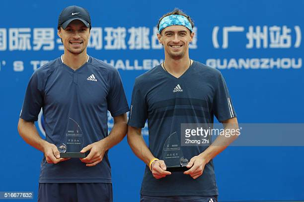 Denys Molchanov of Ukraine and Alexander Kudryavtsev of Russia with their trophy after winning the doubles final match against Sanchai Ratiwatana of...