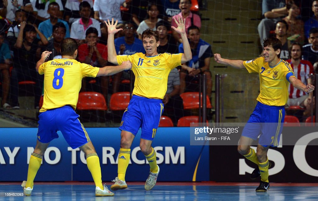 Denys Ovsiannikov of Ukraine (C) celebrates after scoring his teams first goal during the FIFA Futsal World Cup Group A match between Thailand and Ukraine at Indoor Stadium Huamark on November 4, 2012 in Bangkok, Thailand.