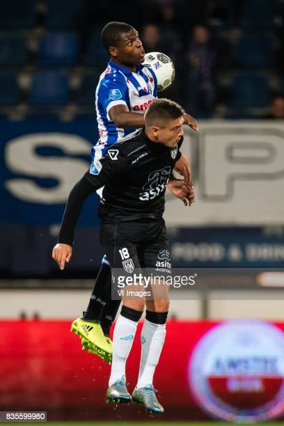 Denzel Dumfries of sc Heerenveen Kristoffer Peterson of Heracles Almelo during the Dutch Eredivisie match between sc Heerenveen and Heracles Almelo...