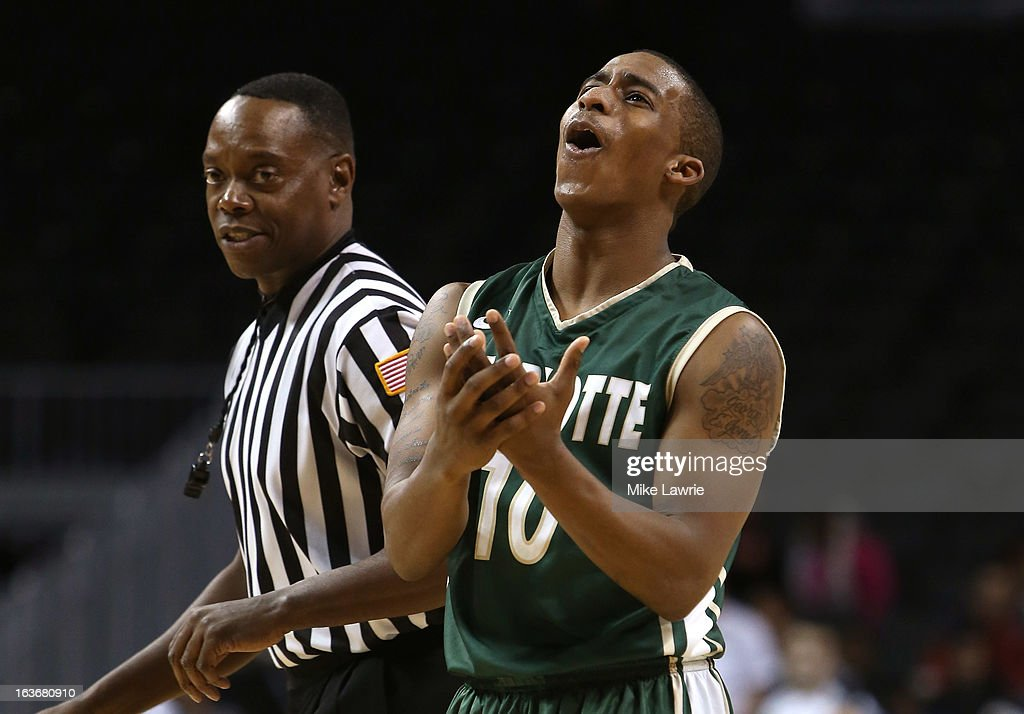 Denzel Ingram #10 of the Charlotte 49ers reacts after a foul is called in the second half against the Richmond Spiders during the first round of the Atlantic 10 basketball tournament at Barclays Center on March 14, 2013 in New York City.
