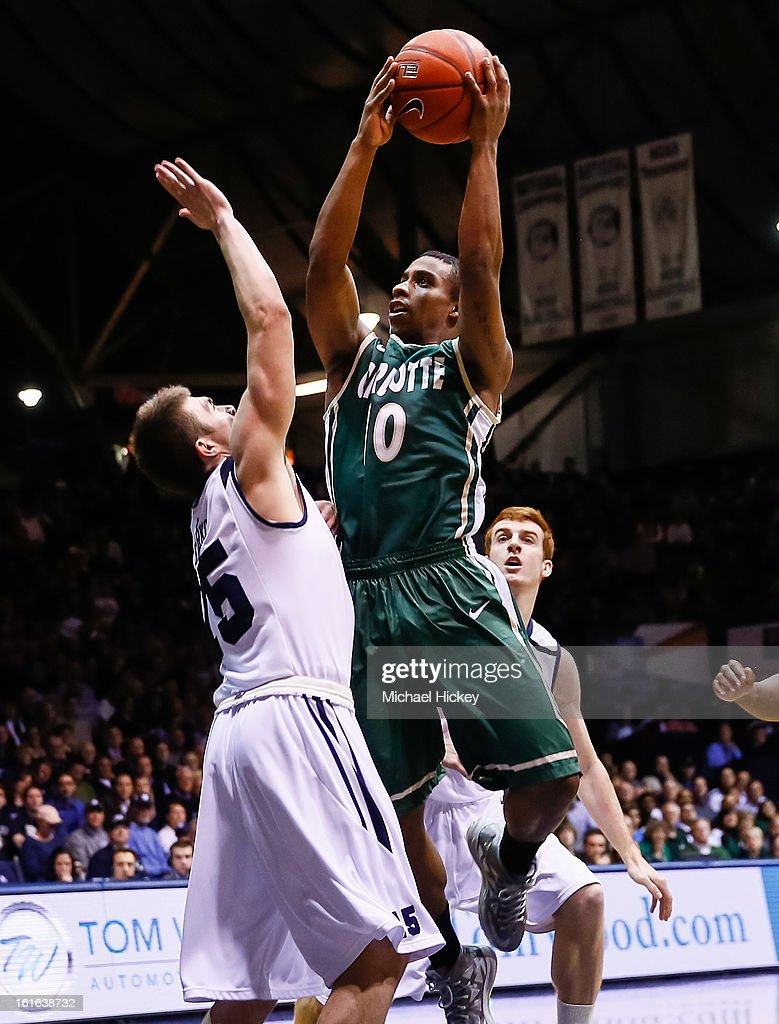 Denzel Ingram #10 of the Charlotte 49ers shoots the ball against Rotnei Clarke #15 of the Butler Bulldogs at Hinkle Fieldhouse on February 13, 2013 in Indianapolis, Indiana. Charlotte defeated Butler 71-67.