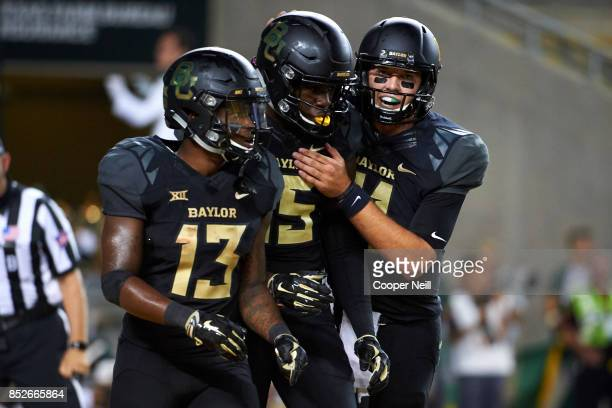 Denzel Mims of the Baylor Bears celebrates after scoring a touchdown with teammates Tony Nicholson and Zach Smith against the Oklahoma Sooners during...