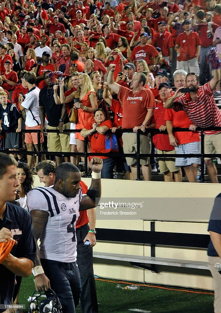Denzel Nkemdiche #4 of the Ole Miss Rebels raises a fist in appreciation of thousands of Ole Miss fans after defeating the Vanderbilt Commodores at Vanderbilt Stadium on August 29, 2013 in Nashville, Tennessee.