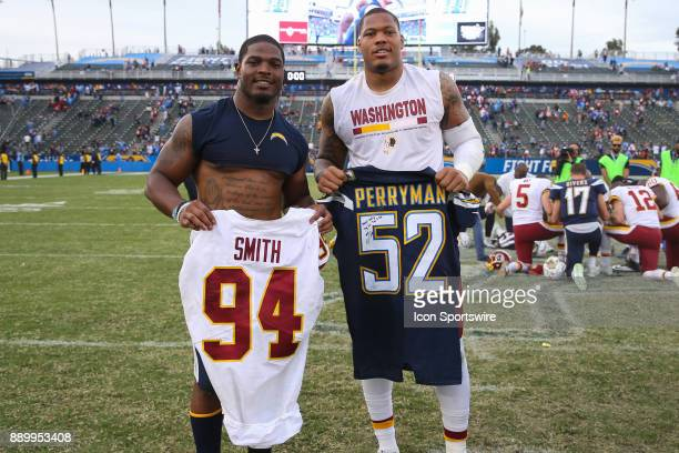 Denzel Perryman of the Los Angeles Chargers and Stacy McGee of the Washington Redskins exchange jerseys after a NFL game between the Washington...