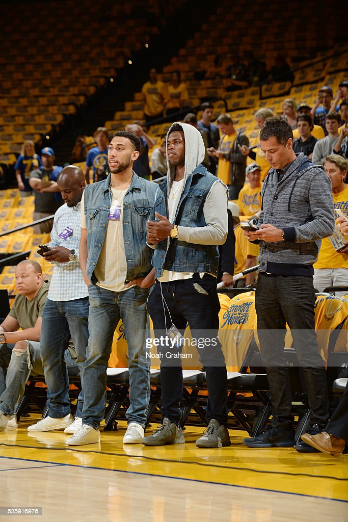 <a gi-track='captionPersonalityLinkClicked' href=/galleries/search?phrase=Denzel+Valentine&family=editorial&specificpeople=9980674 ng-click='$event.stopPropagation()'>Denzel Valentine</a> and <a gi-track='captionPersonalityLinkClicked' href=/galleries/search?phrase=Buddy+Hield&family=editorial&specificpeople=9988395 ng-click='$event.stopPropagation()'>Buddy Hield</a> attend the game between the Golden State Warriors and the Oklahoma City Thunder in Game Seven of the Western Conference Finals during the 2016 NBA Playoffs on May 30, 2016 at ORACLE Arena in Oakland, California.