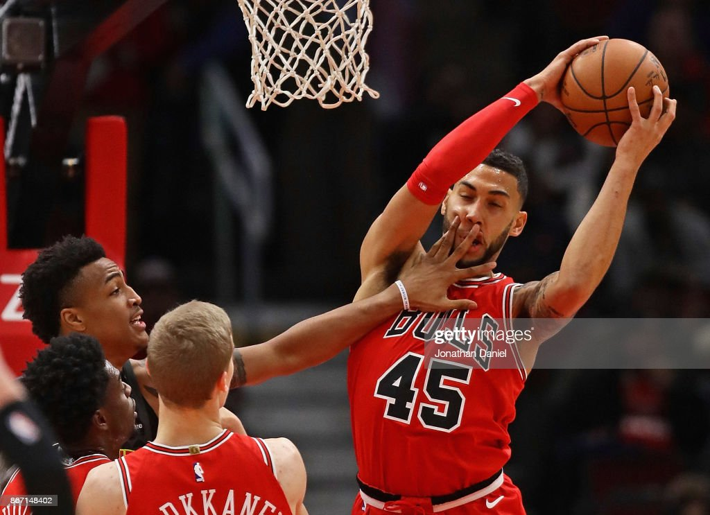 Denzel Valentine #45 of the Chicago Bulls as John Collins #20 of the Atlanta Hawks gets a hand in his face at the United Center on October 26, 2017 in Chicago, Illinois. The Bulls defeated the Hawks 91-86.